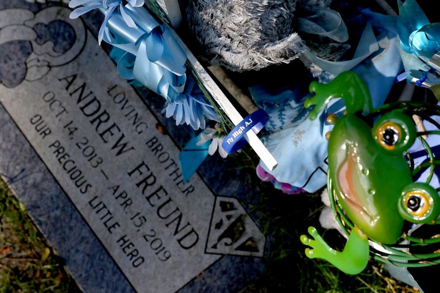 "AJ Freund's gravestone at St. Michael the Archangel Catholic Cemetery in Palatine memorializes him as ""our precious little hero."" He would have turned 6 on Monday."
