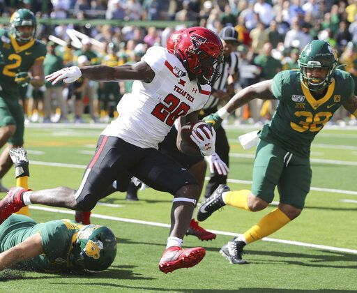 Texas Tech running back SaRodorick Thompson (28) runs against Baylor linebacker Jordan Williams (38) during the first half of a NCAA college football game in Waco, Tex.,Saturday, Oct. 12, 2019.