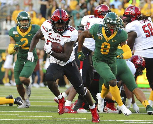 Texas Tech running back SaRodorick Thompson (28) runs past the Baylor defense for a touchdown during the second half of a NCAA college football game in Waco, Tex.,Saturday, Oct. 12, 2019.