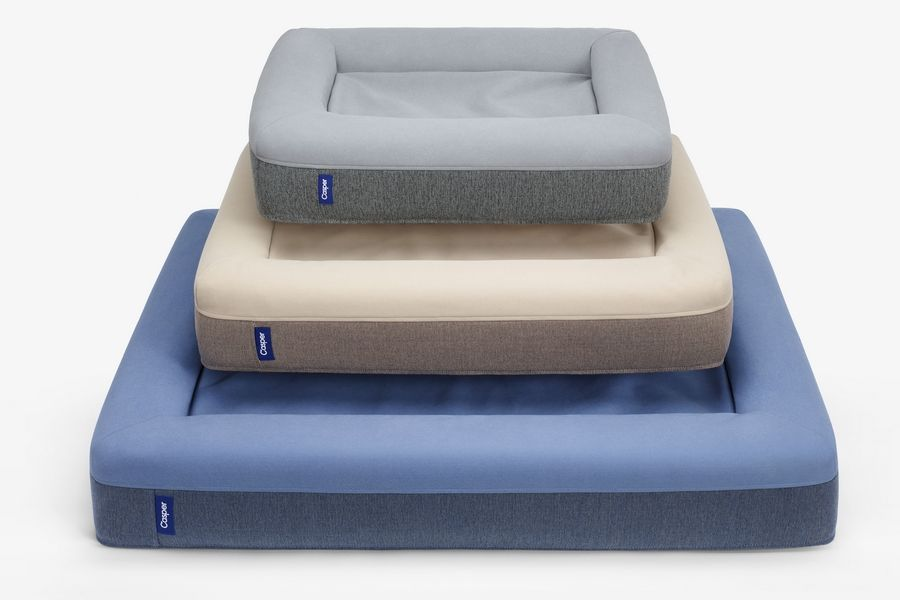 An assortment of Casper's pet beds in different colors and sizes. The beds are made of supportive, comforting foam with a durable, machine-washable outer cover that sheds fur and withstands bites and scratches.