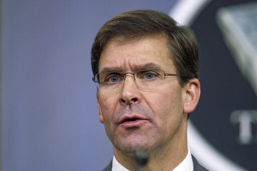 "FILE - In this Aug. 28, 2019, file photo, Secretary of Defense Mark Esper speaks to reporters during a briefing at the Pentagon. Esper says the ""impulsive"" decision by Turkey to invade northern Syria will further destabilize a region already caught up in civil war. Esper says the invasion puts America's Syrian Kurdish partners ""in harm's way,"" but insists the Kurds are not being abandoned."