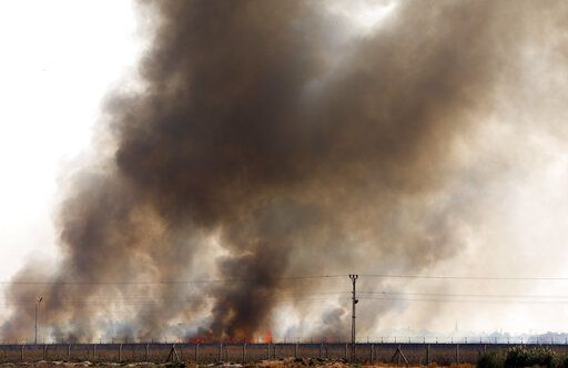 In this photo taken from the Turkish side of the border between Turkey and Syria, in Akcakale, Sanliurfa province, southeastern Turkey, smoke billows from fires on targets in Tel Abyad, Syria, caused by bombardment by Turkish forces, Sunday, Oct. 13, 2019. The United Nations says at least 130,000 people have been displaced by the fighting in northeastern Syria with many more likely on the move as a Turkish offensive in the area enters its fifth day.