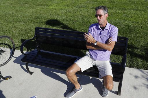 Randall Scott discusses the impeachment inquiry into President Donald Trump while sitting in a park in the Nickel Plate District, Wednesday, Oct. 9, 2019, in Fishers, Ind.