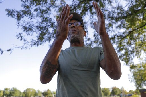 Kevin Bryant discusses the impeachment inquiry into President Donald Trump while walking in a park,Wednesday, Oct. 9, 2019, in Fishers, Ind.