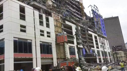 This photo provided by WWL-TV shows several construction standing after a large portion of the Hard Rock Hotel, under construction suddenly collapsed Saturday, Oct. 12, 2019 in New Orleans. It was not immediately clear what caused the collapse or if anyone was injured. Upper floors began to fall on top of each other before one side of the building fell to the ground below. It was not immediately clear what caused the collapse or if anyone was injured. (WWL-TV via AP)