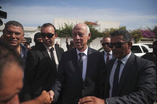 Tunisian independent law professor and presidential candidate Kais Saied arrives to a polling station to cast his ballot during the second round of the presidential election, in Tunis, Tunisia, Sunday, Oct. 13, 2019. Tunisians are voting for president, choosing between a law professor and populist tycoon.