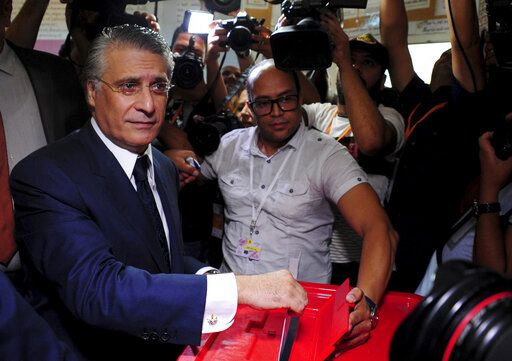 Tunisian media mogul Nabil Karoui casts his ballot at a polling station during the second round of the presidential election, in Tunis, Tunisia, Sunday, Oct. 13, 2019. Tunisians are voting for president, choosing between a law professor and populist tycoon.
