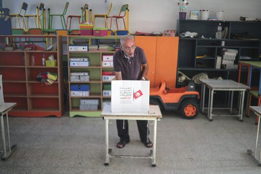 A voter casts his ballot at a polling station during the second round of the presidential election, in Tunis, Tunisia, Sunday, Oct. 13, 2019. Tunisians are voting for president, choosing between a law professor and populist tycoon.