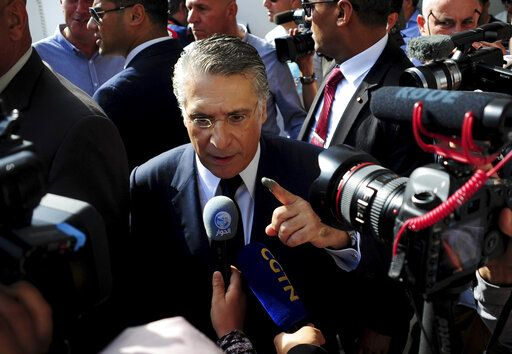 Tunisian media mogul Nabil Karoui speaks to journalists after casting his ballot at a polling station during the second round of the presidential election, in Tunis, Tunisia, Sunday, Oct. 13, 2019. Tunisians are voting for president, choosing between a law professor and populist tycoon.