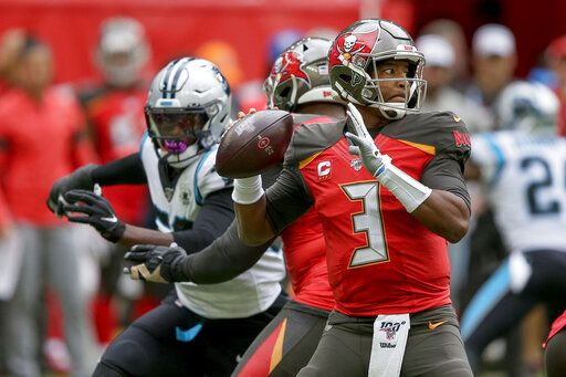 Tampa Bay Buccaneers quarterback Jameis Winston (3) passes against the Carolina Panthers during the second quarter of an NFL football game, Sunday, Oct. 13, 2019, at Tottenham Hotspur Stadium in London.