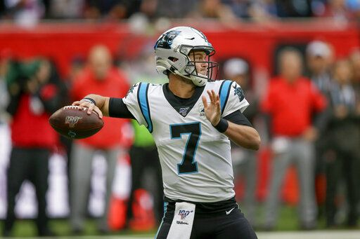 Carolina Panthers quarterback Kyle Allen (7) passes against the Tampa Bay Buccaneers during the second quarter of an NFL football game, Sunday, Oct. 13, 2019, at Tottenham Hotspur Stadium in London.