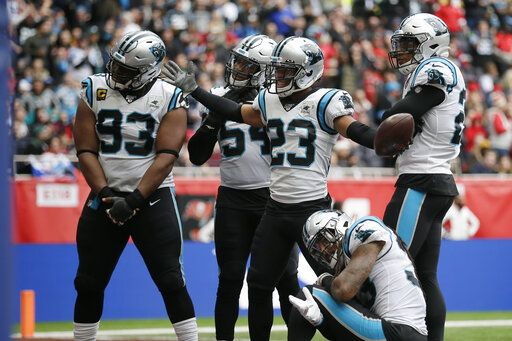 Carolina Panthers cornerback Javien Elliott (23) celebrates with teammates after intercepting a pass against the Tampa Bay Buccaneers during the second quarter of an NFL football game, Sunday, Oct. 13, 2019, at Tottenham Hotspur Stadium in London.