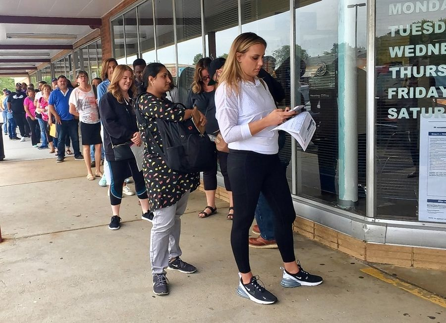 A computer malfunction and demand for REAL ID licenses causes a long line outside the Illinois Secretary of State facility in Lombard on Oct. 1.