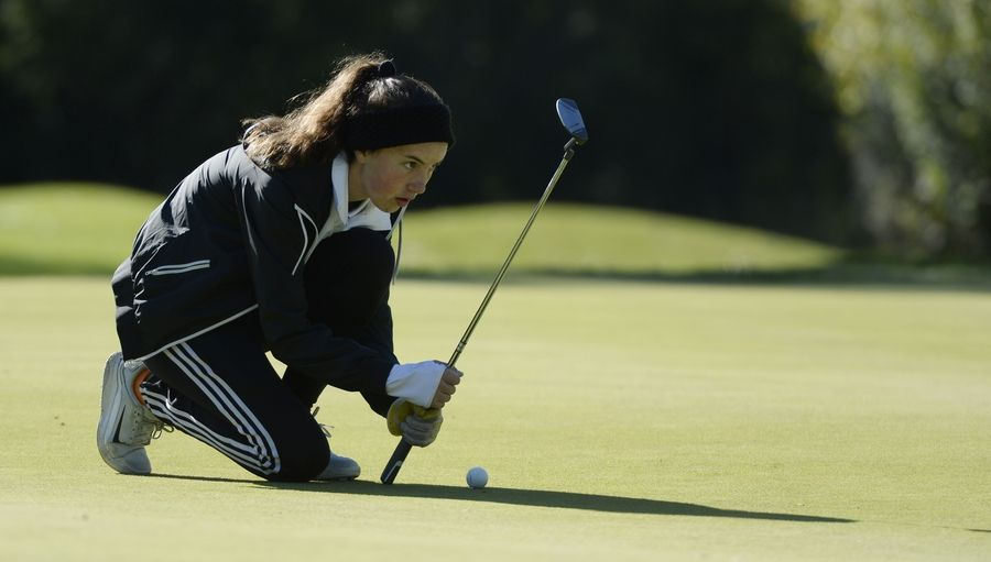 The first hole found Carmel's Maria Stephens lining up her putt in the Class 2A Prospect girls golf sectional in Mount Prospect on Monday.