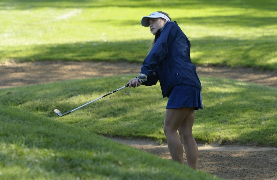 Buffalo Grove's Eva Ruterschmidt chips up to the green on hole No. 14 in the Class 2A Prospect girls golf sectional in Mount Prospect on Monday.