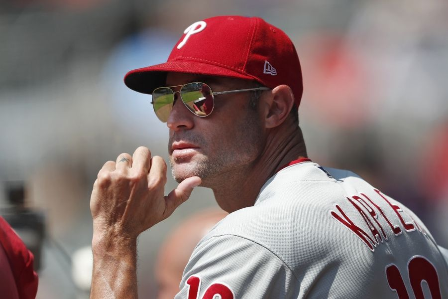 Philadelphia Phillies manager Gabe Kapler watches from the dugout during a baseball game Sept. 19 against the Braves in Atlanta. The Phillies fired Kapler on Thursday, and the Cubs will reportedly interview him for Joe Maddon's old job this week.