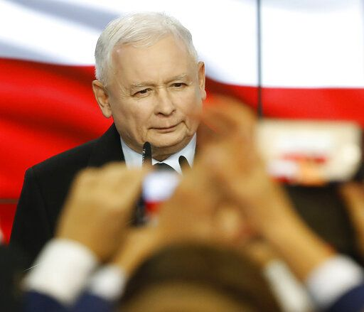 Leader of Poland's ruling party Jaroslaw Kaczynski speaks in reaction to exit poll results right after voting closed in the nation's parliamentary election that is seen crucial for the nation's course in the next four years, in Warsaw , Poland, on Sunday, Oct. 13, 2019.