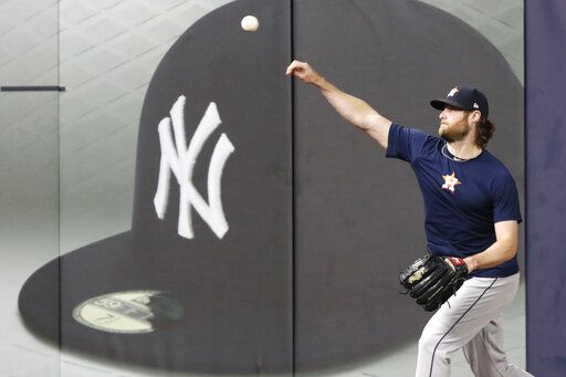 Houston Astros Game 3 starting pitcher Gerrit Cole throws on the field at Yankee Stadium, Monday, Oct. 14, 2019, in New York, after the team arrived to prepare for the American League Championship Series which continues Tuesday against the New York Yankees.