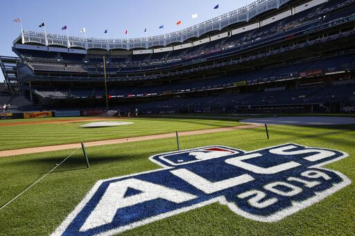 The field is prepped with signage for the American League Championship Series between the New York Yankees and the Houston Astros at Yankee Stadium, Monday, Oct. 14, 2019, in New York. Game 4 in the series, tied at 1-1, is scheduled for Tuesday.