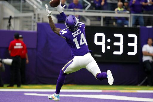 Minnesota Vikings wide receiver Stefon Diggs catches a 51-yard touchdown pass during the first half of an NFL football game against the Philadelphia Eagles, Sunday, Oct. 13, 2019, in Minneapolis.
