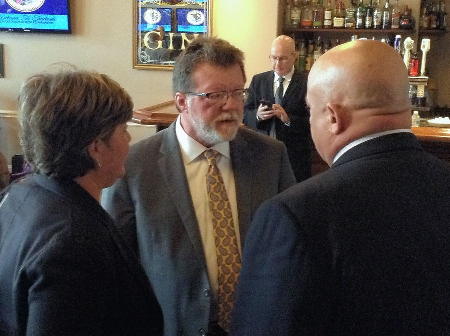Rick Heidner, of Barrington Hills, center, and his lobbyist Julie Curry speak to Illinois Racing Board Chairman Jeffrey Brincat on Tuesday after Heidner's bid to open a proposed Southwest suburban racino fell through.