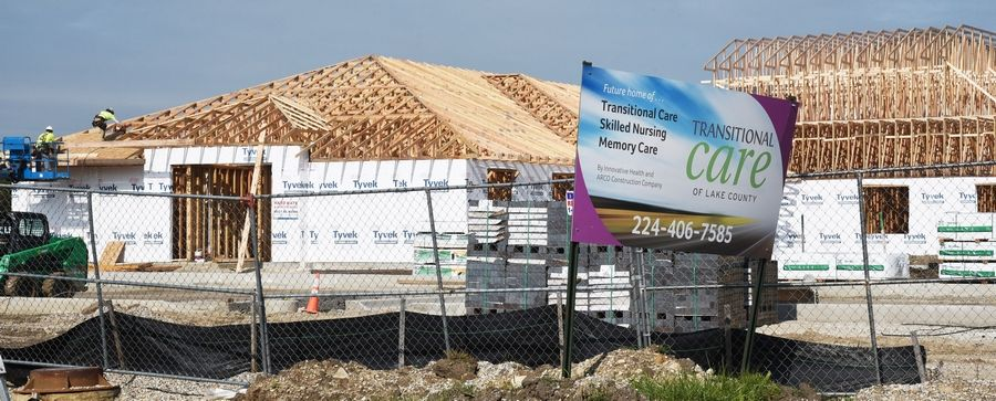 Workers concentrate Tuesday on the roof sections of the new Winchester House skilled nursing home under construction on Route 45 in Mundelein.