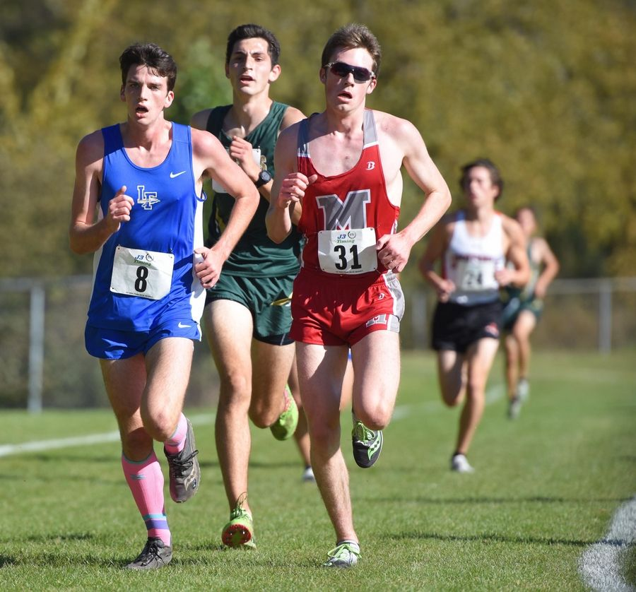 Corey Pacernick, of Stevenson, looks for his opportunity to take the lead from Lake Forest's Nathan Schmitt and Mundelein's Dillon Blake in the North Suburban Conference cross country meet at Lake Forest High School west campus Saturday. Pacernick won the boys varsity race.