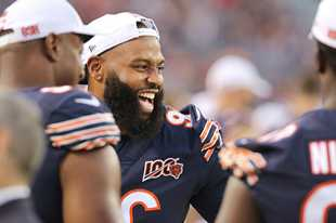 Chicago Bears defensive tackle Akiem Hicks has a laugh on the sidelines during their game against the Tennessee Titans at Soldier Field in Chicago.