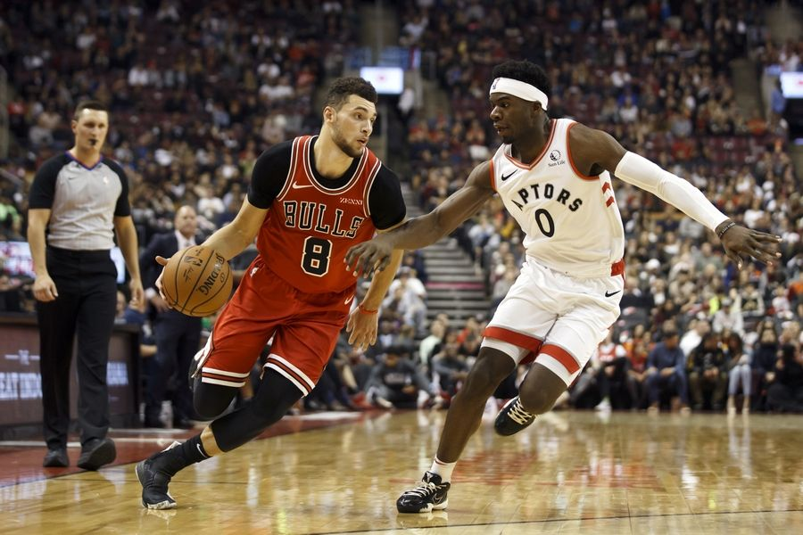 Chicago Bulls guard Zach LaVine (8) drives against Toronto Raptors guard Terence Davis (0) during the first half of their NBA basketball game in Toronto, Sunday, Oct. 13, 2019.