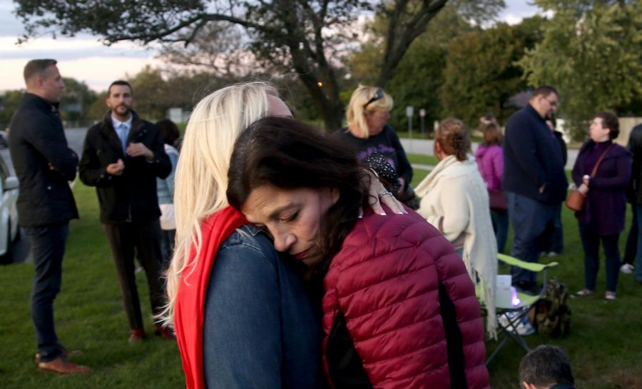 Felicia Miceli of Medinah, right, receives an embrace from Laura Anderson of Elmhurst during a vigil by those who support the Haymarket treatment center proposal before Wednesday's Itasca plan commission meeting at Lake Park High School's west campus in Roselle. Miceli's son died in a 2012 drug overdose.
