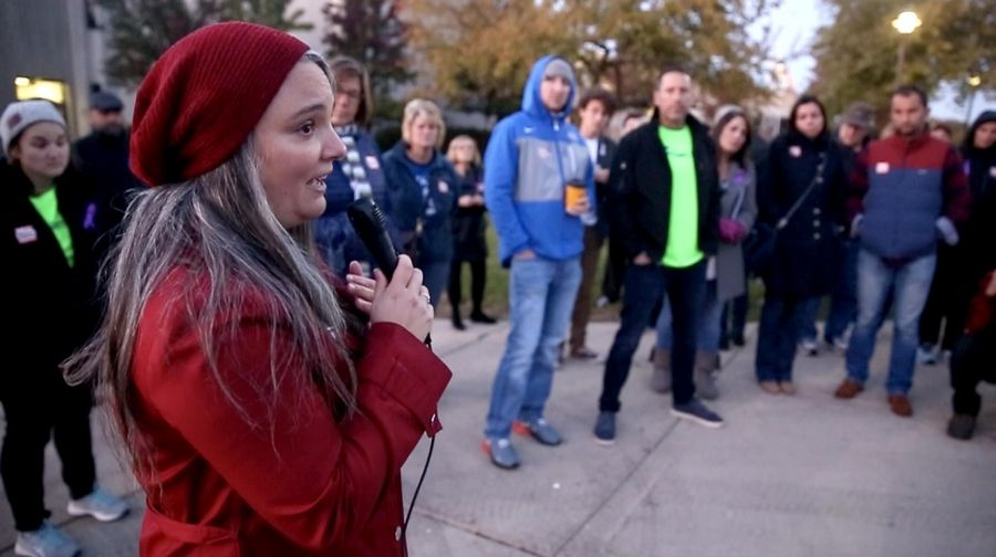 Jennifer Kepp-Muzzo of Itasca asks for a moment of silence Wednesday to remember those who lost their battles with addiction. Kepp-Muzzo and others opposed to a proposal for a Haymarket treatment center in Itasca gather outside the village plan commission meeting at Lake Park High School's west campus in Roselle.