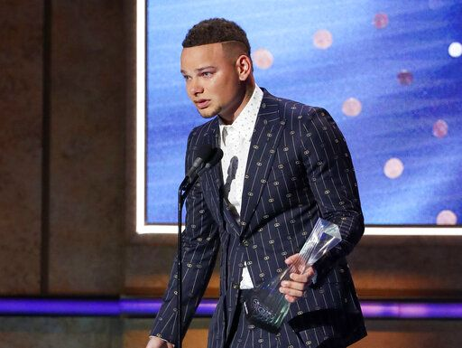 Kane Brown accepts the Artist of the Year Award at 2019 CMT Artists of the Year at Schermerhorn Symphony Center on Wednesday, Oct. 16, 2019, in Nashville, Tenn. (Photo by Al Wagner/Invision/AP)
