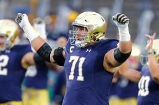 Notre Dame offensive lineman Alex Bars celebrates during last season's win over Stanford. The Bears promoted Alex Bars from the practice squad to the active roster earlier this week in the spot vacated by defensive tackle Akiem Hicks,