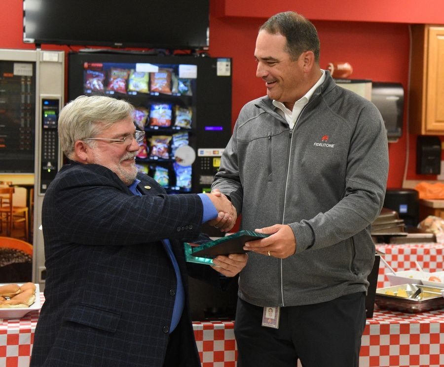 Rick West/rwest@dailyherald.comCEO Josh Johnson shakes hands with Wauconda mayor Lincoln Knight during a luncheon celebration for Fidelitone's 90th anniversary in Wauconda Friday.