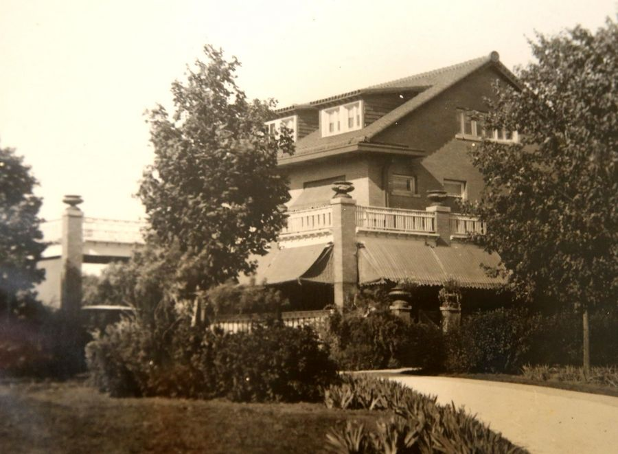 An undated image of the Kroehler mansion in Naperville hangs inside the historic building, which now is used as Mansion High School and operated by the disability services agency Little Friends.