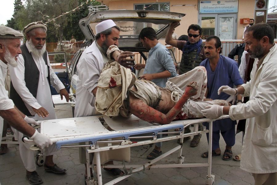 A wounded man is brought by stretcher Friday into a hospital after a mortar was fired by insurgents in Haskamena district of Jalalabad east of Kabul, Afghanistan. An Afghan official says at least several people have been killed during Friday prayers when a mortar fired by insurgents blasted through the roof of a mosque.