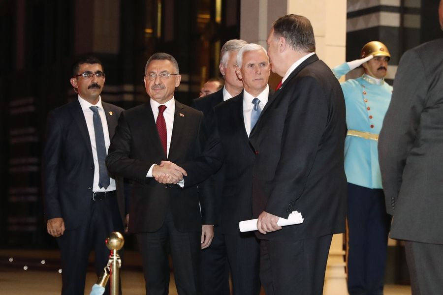 Vice President Mike Pence, center, and Secretary of State Mike Pompeo, right, walk out with Turkish Vice President Fuat Oktay, second left, at the Presidential Palace after meeting Turkish President Recep Tayyip Erdogan, Thursday, Oct. 17, 2019, in Ankara, Turkey, following talks on the Kurds and Syria.