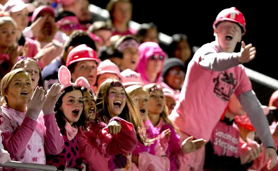 Conant fans cheer the Cougars against Fremd during varsity football in Hoffman Estates Friday.