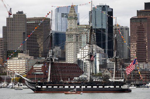 The USS Constitution moves past the skyline in Boston, Friday, Oct. 18, 2019. The ship is making a tour of Boston Harbor in honor of her 222nd birthday as well as the Navy's 244th birthday.