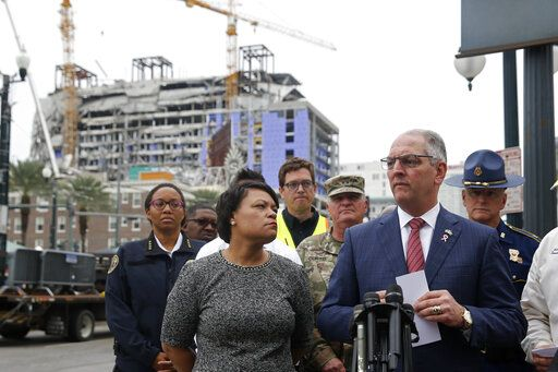 New Orleans Mayor Latoya Cantrell and Louisiana Gov. John Bel Edwards address reporters near the Hard Rock Hotel, Thursday, Oct. 17, 2019, in New Orleans.  The 18-story hotel project that was under construction collapsed last Saturday, killing three workers. Two bodies remain in the wreckage.