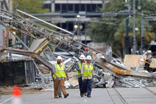 "Workers walk from the site of the Hard Rock Hotel in New Orleans, Wednesday, Oct. 16, 2019. New Orleans officials say the chances of a missing worker's survival after the collapse are diminishing, and they have shifted their efforts from rescue to recovery mode. News outlets report Fire Department Superintendent Tim McConnell says they shifted Wednesday ahead of a possible tropical storm. McConnell says chances of the missing worker's survival will be considered nearly ""zero"" if no sign of him turns up by Wednesday night."