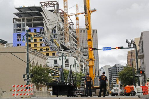 "New Orleans Fire Department personnel stand by the scene of the Hard Rock Hotel in New Orleans, Wednesday, Oct. 16, 2019. New Orleans officials say the chances of a missing worker's survival after the collapse are diminishing, and they have shifted their efforts from rescue to recovery mode. News outlets report Fire Department Superintendent Tim McConnell says they shifted Wednesday ahead of a possible tropical storm. McConnell says chances of the missing worker's survival will be considered nearly ""zero"" if no sign of him turns up by Wednesday night."