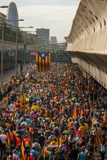 Pro-independence demonstrators march into the city on the fifth day of protests in Barcelona, Spain, Friday, Oct. 18, 2019. The Catalan regional capital is bracing for a fifth day of protests over the conviction of a dozen Catalan independence leaders. Five marches of tens of thousands from inland towns are expected converge in Barcelona's center on Friday afternoon for a mass protest with students to and workers who are on strike.