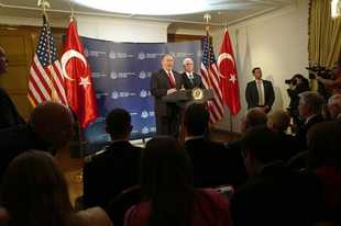 U.S. Secretary of State Mike Pompeo speaks as Vice President Mike Pence listens during a news conference at the U.S. ambassador's residence in Ankara, Turkey, Thursday, Oct. 17, 2019. The U.S. and Turkey agreed to a five-day cease-fire in the Turks' attacks on Kurdish fighters in northern Syria to allow the Kurds to withdraw to roughly 20 miles away from the Turkish border. The arrangement appeared to be a significant embrace of Turkey's position in the weeklong conflict. (AP Photo/Burhan Ozbilici) (AP Photo/Burhan Ozbilici)