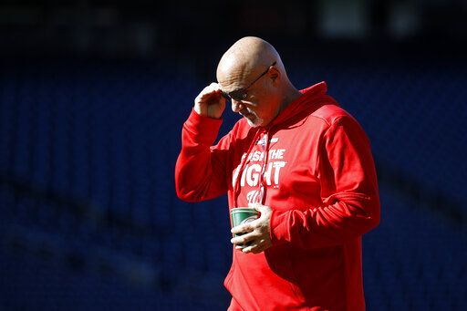 Washington Nationals general manager Mike Rizzo walks on the field during a baseball workout, Friday, Oct. 18, 2019, in Washington, in advance of the team's appearance in the World Series.