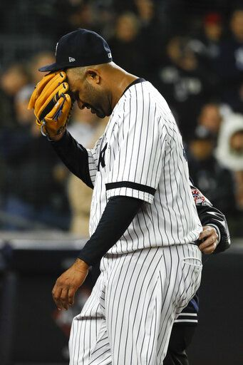 New York Yankees pitcher CC Sabathia is helped off the field during the eighth inning in Game 4 of baseball's American League Championship Series against the Houston Astros Thursday, Oct. 17, 2019, in New York.
