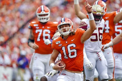 Clemson quarterback Trevor Lawrence (16) reacts after scoring a touchdown during the first half of an NCAA college football game against Florida State, Saturday, Oct. 12, 2019, in Clemson, S.C.