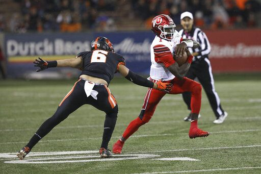 Utah quarterback Tyler Huntley (1) dodges Oregon State outside linebacker John McCartan (6) during the second half of an NCAA college football game in Corvallis, Ore., Saturday, Oct. 12, 2019. Utah won 52-7.
