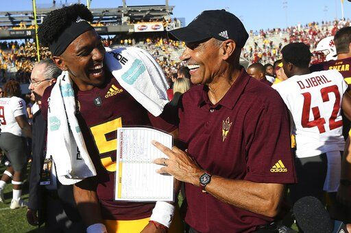 Arizona State quarterback Jayden Daniels (5) celebrates with head coach Herm Edwards, right, after an NCAA college football game win over Washington State, Saturday, Oct. 12, 2019, in Tempe, Ariz.