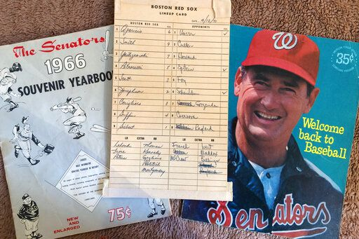 Washington Senators memorabilia including the lineup card from a game between the Senators and Boston Red Sox on April 13, 1971, in Washington, and a program featuring Ted Williams, right, are shown in New York, Tuesday, Oct. 15, 2019.